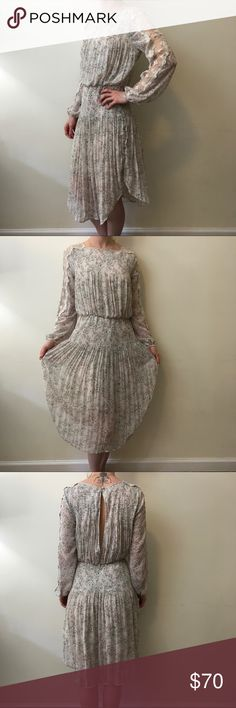 Free People Beige Floral Seventies Lace Midi Dress Midi dress by Free People- Floral and has a stretchy waist area long sleeves and sheer Lace Trim along the top of the long sleeves. Stunning and bohemian- size small and worn a few times! Free People Dresses