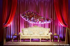 #Backdrop | An Indian bride and groom celebrate their wedding reception after their traditional Sikh ceremony. The bride dons a colorful halter lengha and the decor has a gold and pink color palette.
