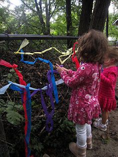 Fence Weaving - using cut up plastic table clothes from a dollar store