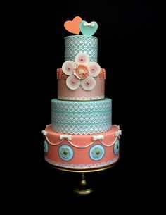Four-Tier Teal and Peach Wedding Cake With Hearts Topper