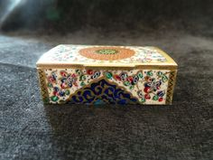 Item Details - Size: 6.8cm X 4.2cm X 2.3cm (WXDXH) - Weight: 60 gr - Material: Glazed Hand Painting on Camel Bone - Origination: Handmade in Isfahan / Persia (Iran) - Usage: Jewelry Box , Small Storage, Decorative Item, Persian Gift Shop @ persianhandicrafts.com