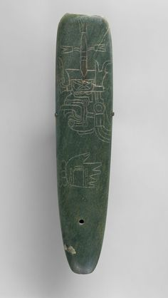 Celt with Incised Profile | Mexico, Mesoamerica | Culture: Olmec | 10th-4th c. BC | A large, finely finished jadeite celt with an engraved profile image of an early Mexican deity was not a working tool but an object of specialized use and sacred signficance.