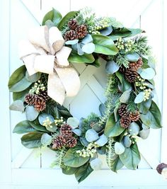 Christmas Wreath ~ Farmhouse Christmas Wreath ~ Cottage Christmas Wreath ~ Magnolia This wreath is full of magnolia, cedar, pale green berries, pinecones and eucalyptus. Each of these elements has a very realistic look! It is topped off with a white polka dotted linen bow. It is all attached to a natural grapevine base. A beautiful indoor or outdoor wreath. The wreath measures approximately 22 in diameter. There is a small wire hanger on the back. If this is a gift, I would be glad to…