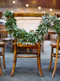 Rustic ivy garland adorned bride's chair: http://www.stylemepretty.com/2014/08/19/sonoma-ranch-wedding-inspired-by-all-things-french/ | Photography: Jose Villa - http://josevilla.com/
