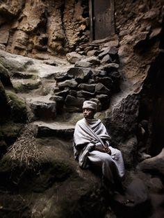 """Ethiopian boy in a cavern church:  """"Fear?  I have no fear because I follow God."""""""