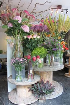 Flower shop display | How Do It Info - all glass looks nice, but would be hard to keep the water clean