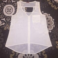 """Sheer sleeveless top with cut-out detail Fun sleeveless sheer cream top with cut-out in the back. Back also has a row of gold buttons going down it. They're just for detail. 1 breast pocket on the front. High-low with the front measuring approximately 22 1/2"""" and the back measuring approximately 27 1/2"""". 18 1/2"""" wide from armpit to armpit while laying flat and 22 1/2"""" at the widest part. Looks great with jeans! Tops"""