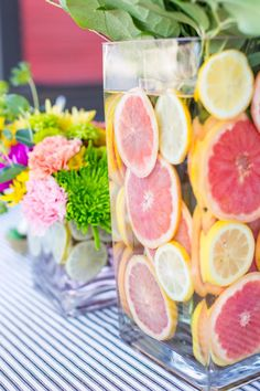 Add an extra layer of creativity and color to your centerpiece. The trick is to use two vases -- one just a bit smaller than the other. Place the smaller vase inside the larger, then fill the gap between the vases with orange, lemon, lime or grapefruit slices and water to keep the fruit hydrated. Get more tips plus step-by-step instructions for recreating this look.