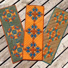 A Half Yard Bundle of any 8-step gradation will make THREE table runners as shown. This is the same block, just different layouts. It's amazing how the placement of color can change the design!Design by Loretta Stacy.12″ x 34″ each