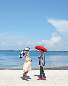 Posing at the water's edge with cool parasols in Useppa, Florida