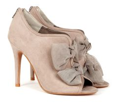 Peep toe shoetie with back zip closure and bow detail.