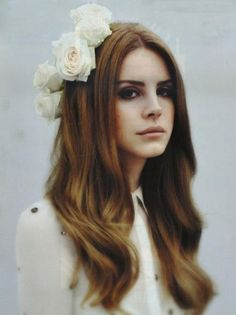 badass.iconic.bitch. Lana Del Rey, If I could channel her 'I don't give a fuck, and I'm also wearing giant flowers and red lipstick' everyday i would.