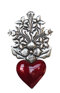Tin heart with floral bouquet is handmade by renowned Oaxacan tinsmith Conrado Villegas.  Measures 6 inches tall. Buy one at Viva Oaxaca Folk Art.
