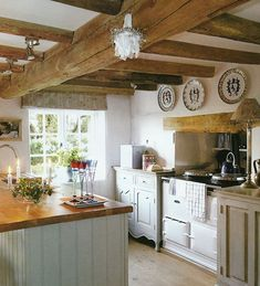 Beautiful European Country Kitchens {Decor Inspiration} Beautiful European country kitchen with rustic wood beamed ceiling and plates hung on wall.Beautiful European country kitchen with rustic wood beamed ceiling and plates hung on wall. Kitchen Ikea, New Kitchen, Kitchen Dining, Kitchen Decor, Kitchen Cabinets, Rustic Cabinets, Kitchen Wood, Decorating Kitchen, Kitchen White