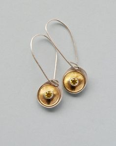 Silver and gold drop earrings set with yellow faceted stones. Handmade by Reshma Tia Champaneria