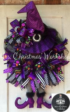 This is a flying witch Halloween wreath made with purple and black deco mesh and features a witch hat and witch legs. She fabulous and will get your door noticed this Halloween! Wreath measures 24H x 24W not including hat and boots. Shes a biggie and costs a little more to ship. See more items http://www.etsy.com/shop/mrschristmasworkshop
