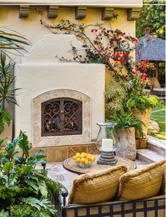 I totally LOVE this one for outside.  I like the brick from the colonnade around the outside, and the plain stucco, with a dark stain or painted wood mantle above it.  Those doors are just yummy, and the terra cotta tile at the bottom.  How wonderful its that?!?!?!  I like this enough that I would do the same one in the family room, maybe with the decorative tile rather than the brick around it.