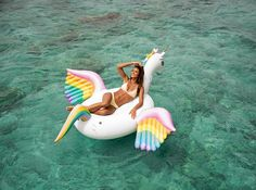 This summer's hottest pool float by FUNBOY. Giant Rainbow Unicorn Float. Free shipping.