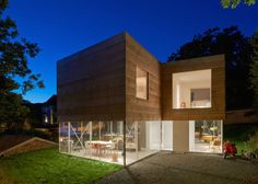 A glassed-in first floor in Mölle, Sweden, makes the home appear to hover over the ground.
