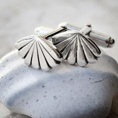 Sterling silver shell cufflinks would look lovely on your groom's sleeve