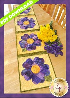 Patchwork Pansy Table Runner - PDF DOWNLOAD: THIS PRODUCT IS A PDF DOWNLOAD that must be downloaded and printed by the customer. A paper copy of the pattern will not be sent to you. Create a darling table runner for spring! Designed by Jennifer Bosworth of Shabby Fabrics, this design features patchwork - a great way to use up scraps! - and applique. Pattern includes all instructions for the 12 1/2