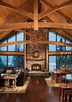 Photos of a timber frame cabin on a lake in northern Alberta. This lakeside cabin provides amazing views of the countryside from within a warm structure. Mountain Homes, Mountain Home Plans, Mountain House Decor, Mountain Cabins, Mountain Living, Log Cabin Homes, Log Cabins, Log Cabin Floor Plans, Cabin House Plans