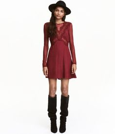 Dark red. Short dress in crêped viscose with lace inserts. Opening at back of neck with button, long sleeves and yoke in mesh, concealed side zip, and