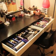The sliding drawers with the sleek table might be my absolute favorite.  I could put jewelry in teacups in there too!
