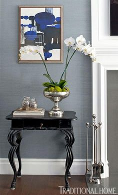 Blue and white classic American style home of BIll and Guiliana Rancic as feautred in Traditional Home magazine