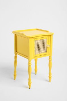 I love the idea of a bright yellow table so much, but can't quite justify $149 for a table I can find in the antique down the street for a fraction of the price. So, drumroll please, I painted my own old little plant stand this fabulous pop of color! Now I have my own little yellow table.