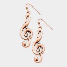 """Copper toned treble clef earrings. 0.6"""" W, 2"""" L"""