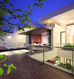 Apply our surfaces protector Faceal Oleo HD on wood patio.  Photo: House in Jakarta by TWS