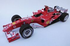 This F1 paper car is a 2004 Hungarian GP Ferrari F2004, a highly successful Formula One racing car designed by Rory Byrne, Ross Brawn and Aldo Costa for the 2004 Formula One season, the paper model is created by F1 Fomula Team Forum, and the scale is in 1:24.