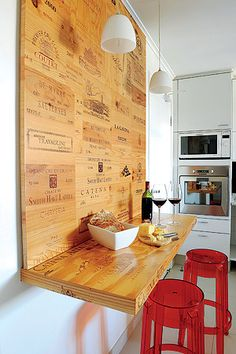 Repurpose wine crates by creating a counter with stools for extra seating and serving space.