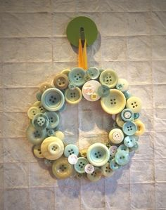 wreath made with buttons  This would make a great frame for a new baby and have it say, Cute as a button