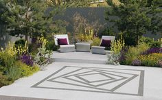 Striking use of paving, colour and planting in a small patio garden.