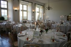 eclectic mix of Silver candelabras and candle sticks strung with pearls, decorated with jam jar posies