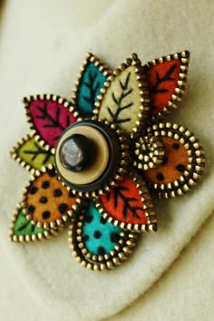 Petals and leaves brooch by woolly  fabulous, via Flickr
