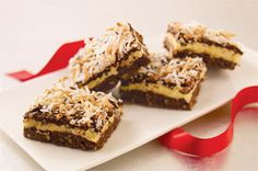 Layered Coconut-Chocolate Bars Recipe - pkg.  (4 oz. each) BAKER'S Semi-Sweet Chocolate, divided 3/4 cup  butter, divided 1-1/2 cups  graham cracker crumbs 2/3 cup  finely chopped toasted PLANTERS Walnuts 1 pkg.  (7 oz.) BAKER'S ANGEL FLAKE Coconut (2-2/3 cups), toasted, divided 1 pkg.  (8 oz.) PHILADELPHIA Cream Cheese, softened 1/2 cup  cold milk 1 pkg.  (3.4 oz.) JELL-O Vanilla Flavor Instant Pudding
