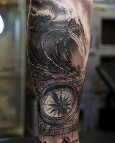 compass and wave tattoo