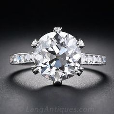 Tiffany & Co. 3.88 Carat Antique Diamond Ring, circa 1920.  A gorgeous antique cushion-cut diamond, weighing just twelve points shy of 4.00 carats, and accompanied by a G.I.A. diamond certificate stating: J color - VS1 clarity, is exquisitely presented in a gorgeous platinum and diamond solitaire setting.