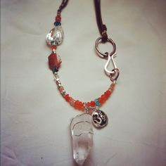 Om necklace with carnelian and quartz and fine silver cast charm.