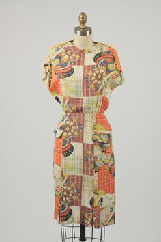 1940s rayon dress with Bakelite shoulder buttons
