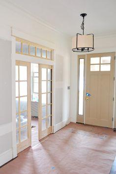 Paint, Light Fixtures, Doorknobs, & Green Vanities 10' ceilings/transom above pocket doors