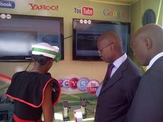Peter Arina of Safaricom and Bill Owino of Qualcomm checking stuff out