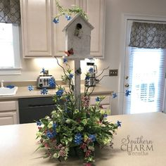 This arrangement would be perfect for a buffet, wedding table centerpiece, fireplace or anywhere you want a little bit of outside brought in. Check out the tutorial video for this DIY birdhouse flower arrangement. Spring Door Wreaths, Summer Wreath, Wreaths For Front Door, Mesh Wreaths, Decorative Bird Houses, Bird Houses Diy, Silk Flower Arrangements, Table Arrangements, As You Like