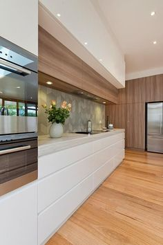 Love this two-toned elegant kitchen look! Look to REHAU to service all your cabinet door needs: http://na.rehau.com/cabinetdoors