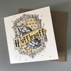 This 'Hufflepuff' card design is a perfect gift idea for any fan of the Harry Potter series! The design is taken from an original watercolour painting by shop-owner Margaret Shepherd, featuring the Hufflepuff House crest. Each card measures x Harry Potter Birthday Cards, Harry Potter Cards, Harry Potter Items, Funny Birthday Cards, Handmade Birthday Cards, Birthday Greeting Cards, Birthday Greetings, Personalised Gifts Handmade, Printable Cards