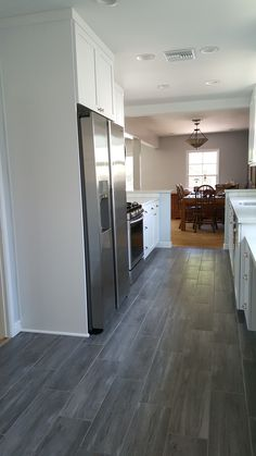Tile flooring that resembles wood. Kitchen remodel by state wide construction and remodeling in Los Angeles. Free estimate. Call 818-633-5462