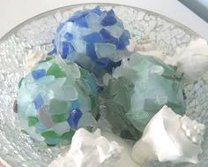 You can often pick up bags of these sea glass pebbles at the Dollar Tree.  Just glue on any ball shape and you have beautiful items to fill a display bowl on an entry table, coffee table or even dining table.